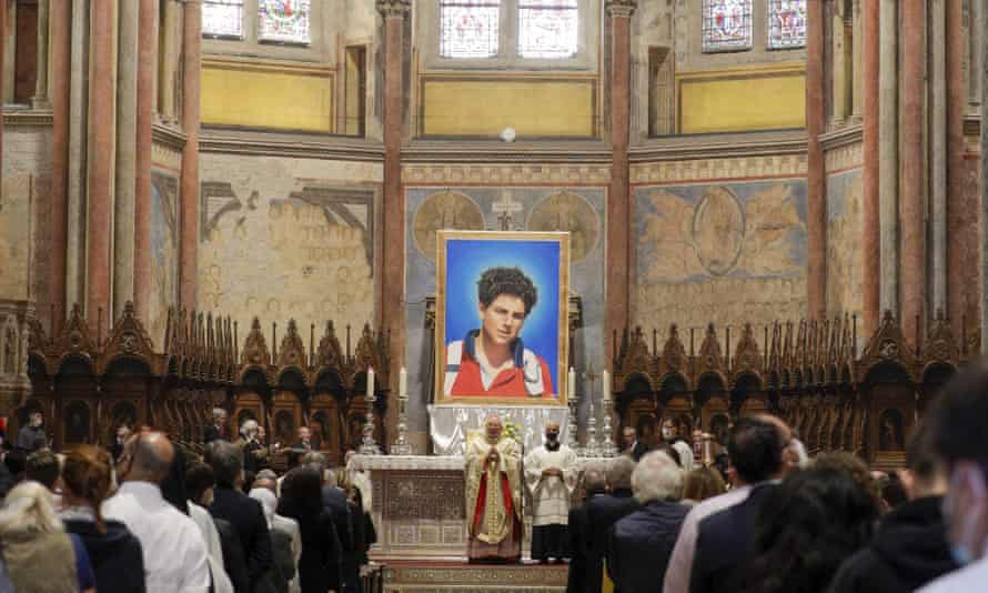 An image of Carlo Acutis, who died in 2006 of leukaemia, is seen during his beatification ceremony St Francis Basilica in Assisi, Italy