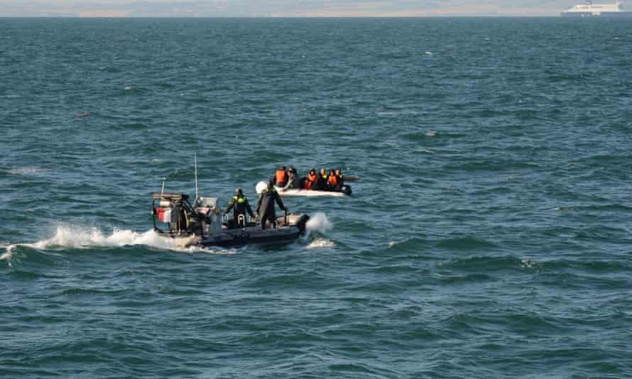 French authorities go to rescue of migrants whose boat capsized in the Channel.