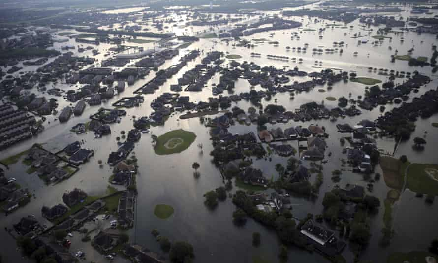 Floodwaters from Tropical Storm Harvey surround homes in Port Arthur, Texas, on Aug. 31, 2017.