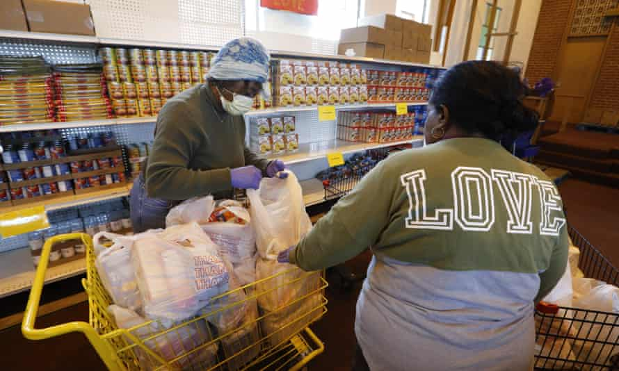 Volunteers Brenda Chambers, left, and Theretha Dixon at the Brightmoor Connection Food Pantry in Detroit.