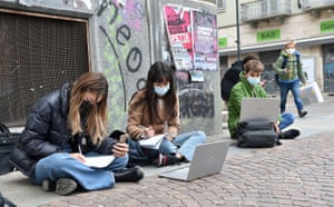 Turin, Italy: Students study on the street due to school closures imposed by the government as a response to an increase in Covid-19 disease infections