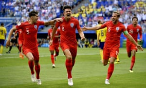 Harry Maguire celebrates his goal with John Stones and Harry Kane.
