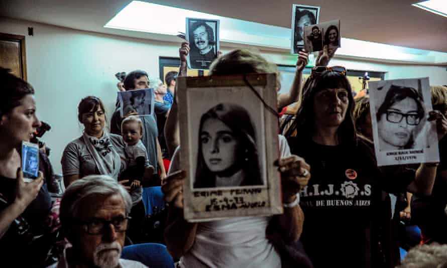 Relatives of those who disappeared listen to the sentencing hearing in Buenos Aires on Wednesday.
