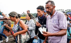 Venezuelans cross the Simon Bolivar International Bridge into Colombia. His detractors blame him for the country's economic crisis, which has caused 2.3 million to flee the country since 2015.