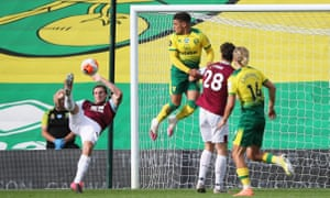 Burnley's Chris Wood (left) opens the scoring in acrobatic style.