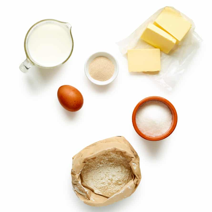 Using a mixer, combine the flour, yeast, sugar and salt with the milk, egg yolk and cooled melted butter until you have a smooth dough.