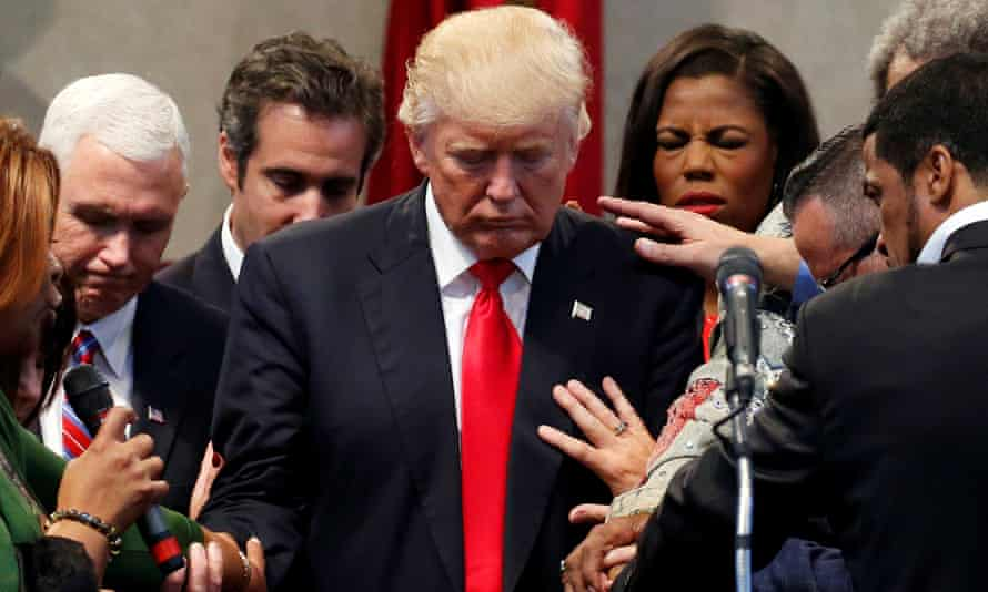 Clergy lay hands and pray with Donald Trump at the New Spirit Revival Center in Cleveland Heights, Ohio on Wednesday.
