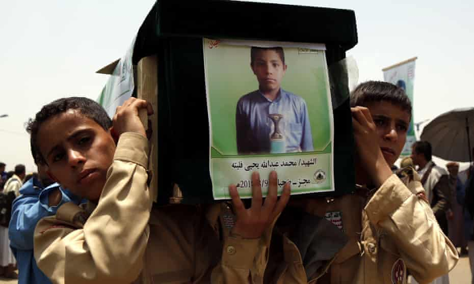Boys carry the coffin of one of the dozens of child victims of a Saudi-led airstrike in Yemen