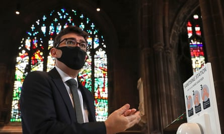 Andy Burnham sanitises his hands before a memorial service for the victims of coronavirus at Manchester Cathedral in Manchester, north-west England.