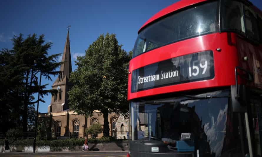 An Abellio bus passes a church in south London.