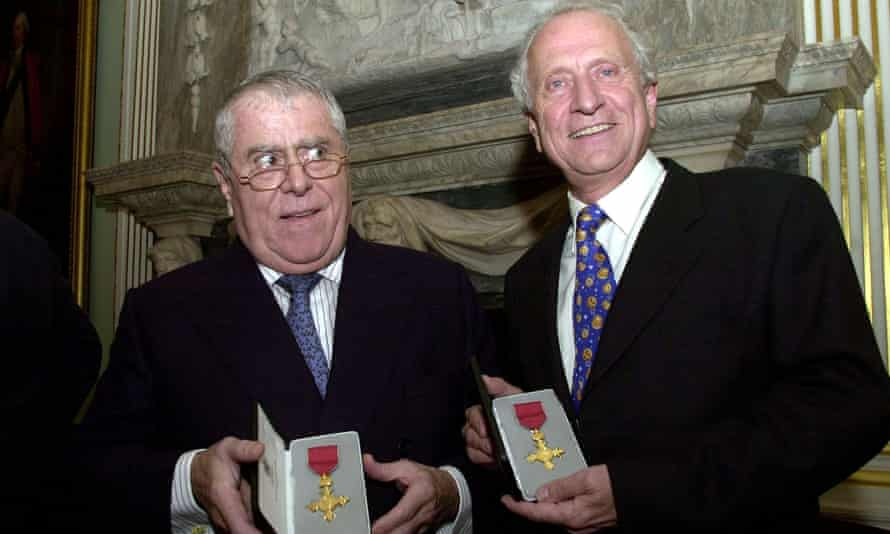 Albert Roux, left, and his brother, Michel, receiving their OBEs in 2002.