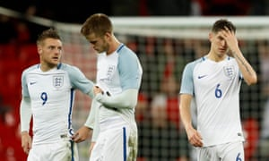 Jamie Vardy, Eric Dier and John Stones look dejected at the end of the match.