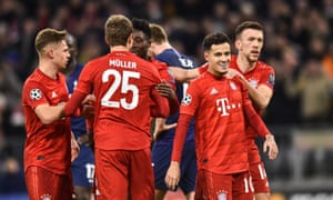 Philippe Coutinho celebrates with Bayern teammates after making it 3-1.