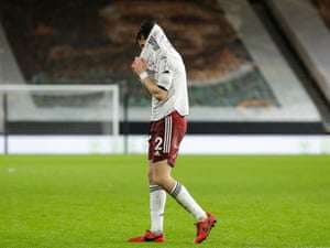 Arsenal's Hector Bellerin trudges off after the final whistle.