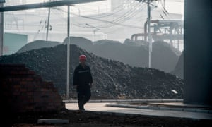 A worker walking by the main gate of a coal-to-oil plant in Changzhi in China's northern Shanxi province.