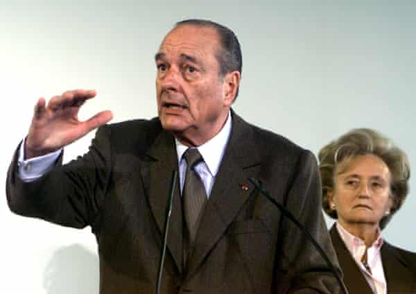 Jacques Chirac delivering a speech while his wife, Bernadette, listens, at the Saint Quentin city hall, March 2002.