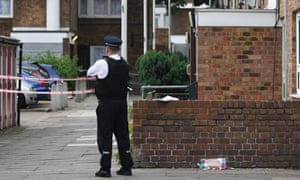 A police officer at the scene of a shooting in London