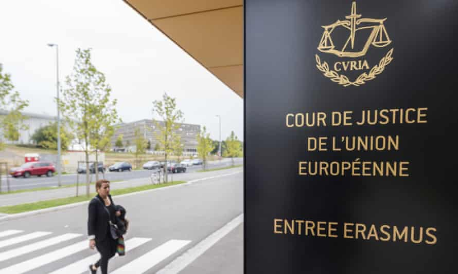 A woman walks by the entrance to the European Court of Justice in Luxembourg.