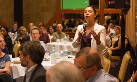 An attendee of the Guardian conference on green chemistry asks a question during a panel with speakers Paul Anastas and John Warner.