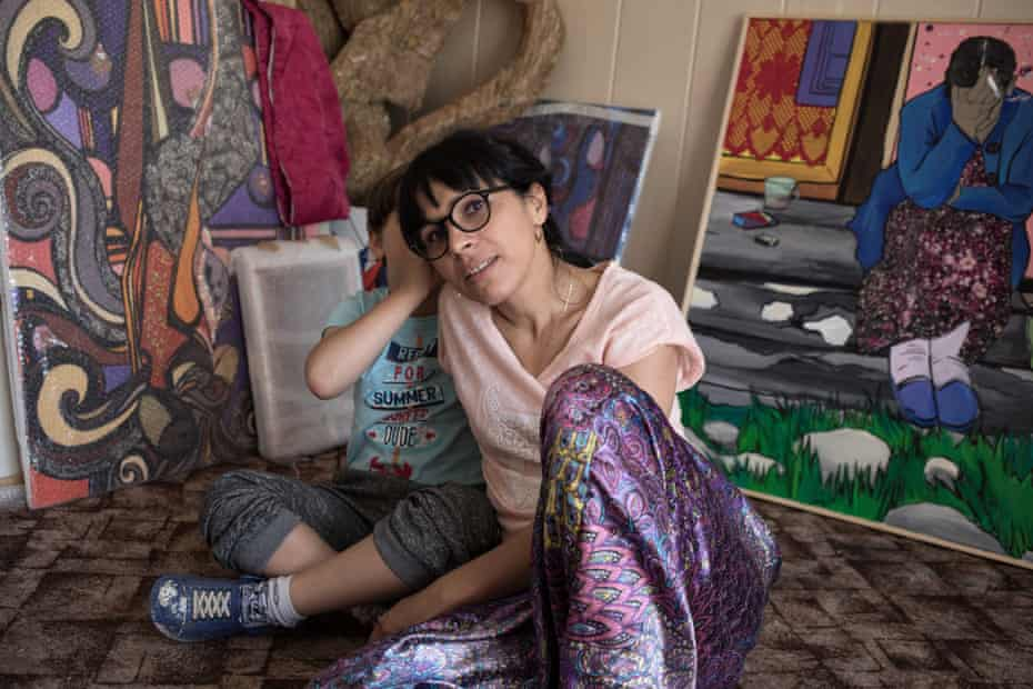 Polish Roma artist Gosia Mirga and her son Ignacy, six, with her paintings
