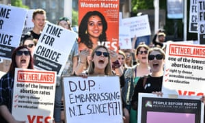 Abortion rights campaigners rally outside Belfast city hall.
