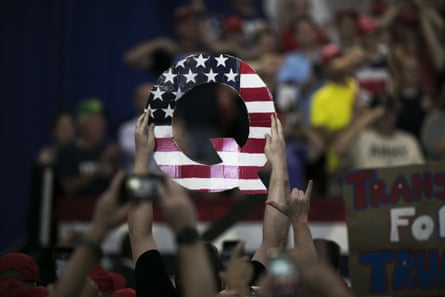 An attendee holds signs a Q sign at a Trump rally in Lewis Center, Ohio, 4 August 2018.