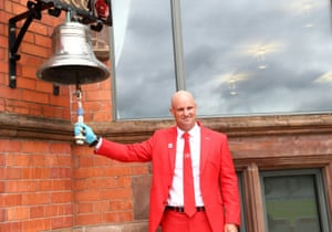 Andrew Strauss rings a bell to signify the start of play.