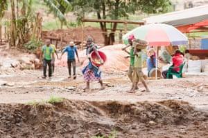 Children at work on a gold mine in Uganda