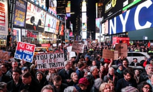 People take part in the 'No one is above the law' protest in Times Square, New York