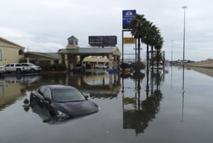 Several cars were flooded along Interstate 10 in south-east Texas Thursday.