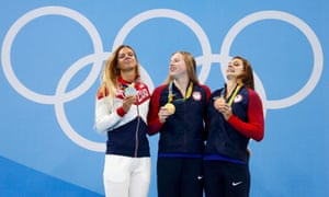 Yulia Efimova with her silver medal, alongside US pair Lilly King and Katie Meili.