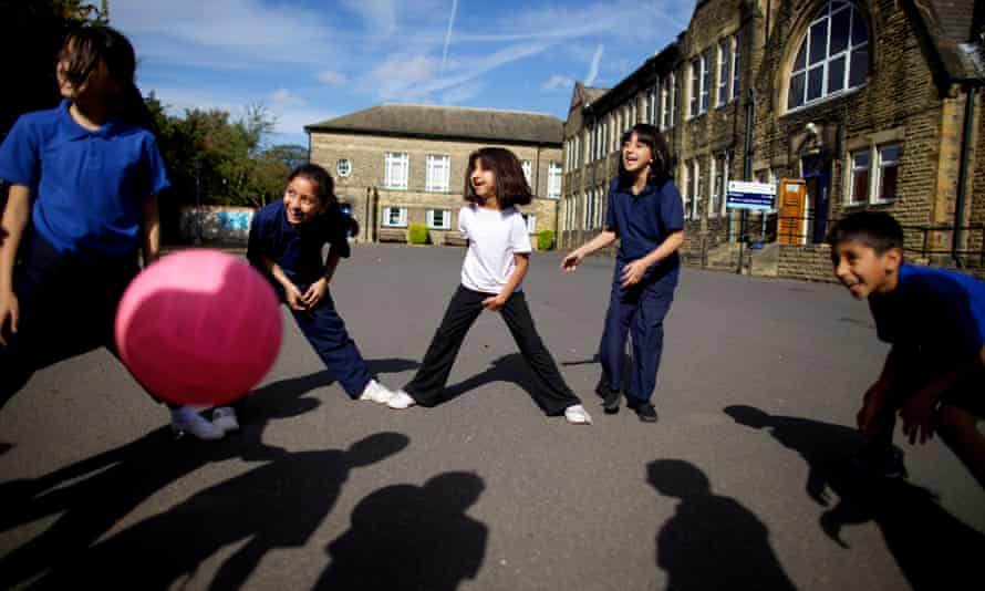 Pupils playing with ball in school