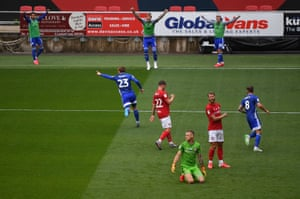 Danny Ward of Cardiff City (centre) celebrates with his team mates after scoring his side's first goal.