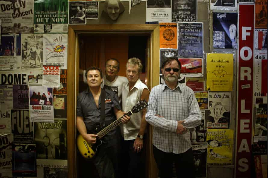 Members from the band Daddy Cool upon reforming after 30 years to play a charity gig.