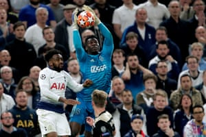 Danny Rose of Tottenham Hotspur fouls Ajax keeper Andre Onana.