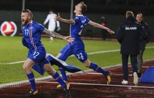 Iceland's Aron Einar Gunnarsson and Jon Dadi Bodvarsson celebrate at the final whistle.