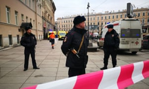 Police officers guard the area at the entrance to Technological Institute metro station in St Petersburg