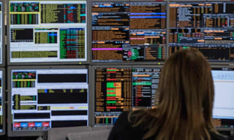 A trader working at their computer