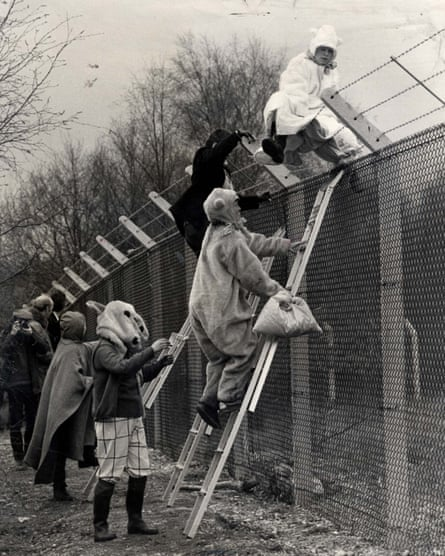 Climbing the Greenham fence dressed as teddy bears in 1983.