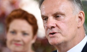 Mark Latham with Pauline Hanson in the background