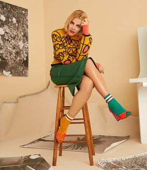 Busy Philipps. Sweater and skirt by Fendi; turtleneck by Arias salmon; earrings by Melinda Maria; socks by Topman; and shoes by Pierre Hardy.