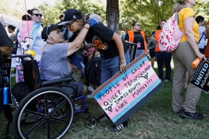 Modesto, US: Two demonstrators embrace each other during a protest against a planned straight pride parade in Modesto in northern California