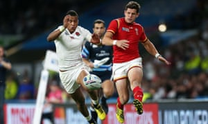 Lloyd Williams of Wales chips the ball to team-mate Gareth Davies who went on to score a try against England