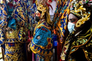 Members of a Chinese opera troupe prepare backstage during the annual vegetarian festival in Bangkok, Thailand.