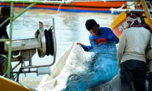 Fishermen inspect their nets in Kuala Muda, near the border between Penang and Kedah, Malaysia