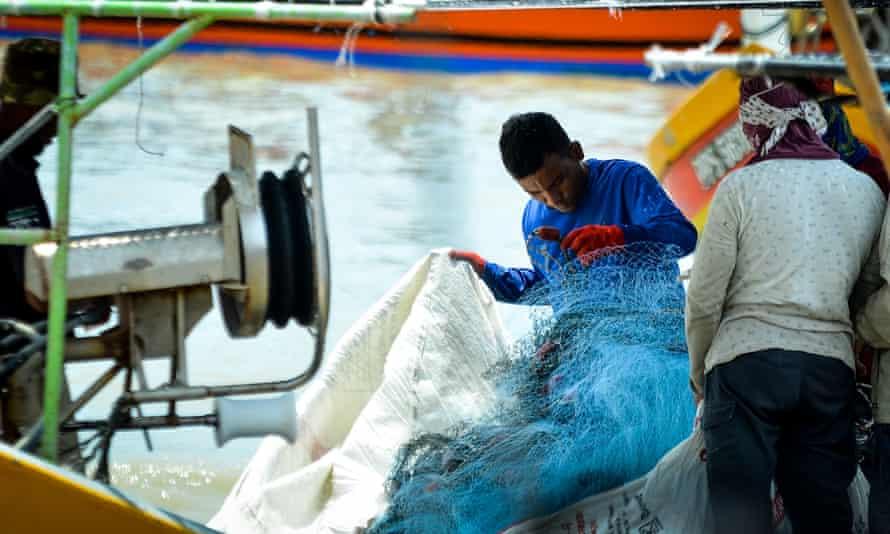 Fishermen inspect their nets in Kuala Muda, near the border between Penang and Kedah, Malaysia