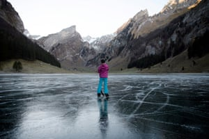 Seealpsee, Switzerland A girl enjoys a day on the black ice of the frozen Seealpsee