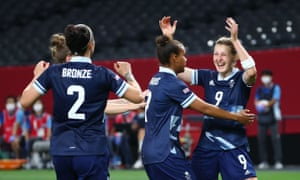 Ellen White of Britain celebrates with teammates after scoring her second goal.
