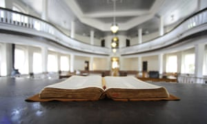 "This July 8, 2015, photo, shows a Bible opened on the judge's desk in the old Monroe County Courthouse in Monroeville, Ala. The building is a centerpiece in the hometown of ""To Kill a Mockingbird"" author Harper Lee, whose second book ""Go Set a Watchman"" is set for release July 14, 2015. The courtroom was used as a model for the film adaptation of ""Mockingbird."" (AP Photo/Jay Reeves)"