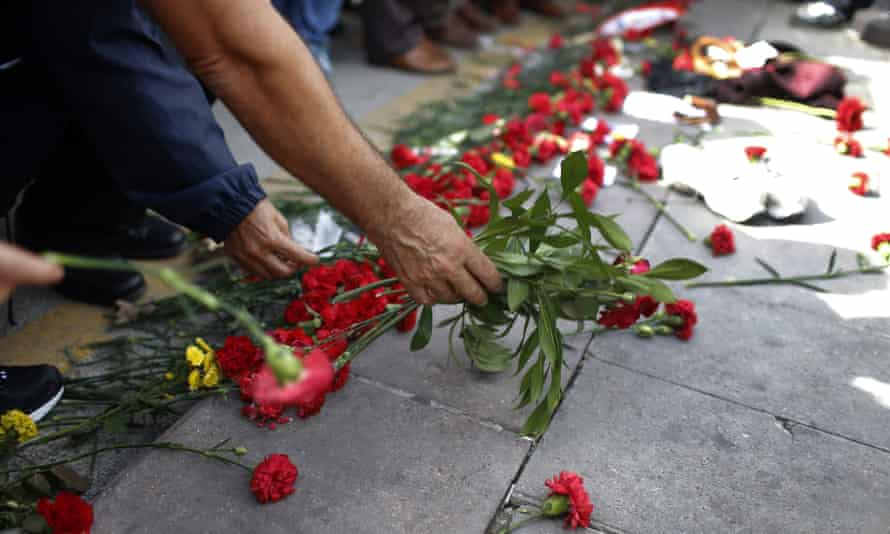 People leaving flowers near the site of the explosions